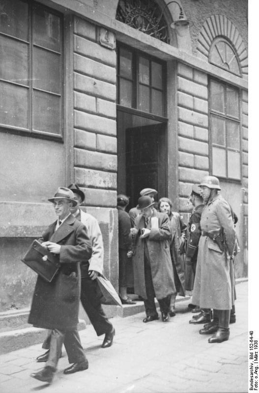 SS-Razzia at the Israelitische Kultusgemeinde Wien, March 1938; Bundesarchiv, Bild 152-64-40 / CC-BY-SA 3.0 [CC BY-SA 3.0 de (https://creativecommons.org/licenses/by-sa/3.0/de/deed.en)], via Wikimedia Commons